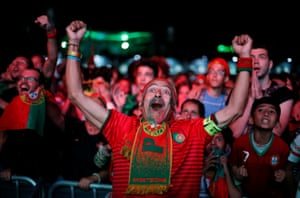 Fans react as they watch Portugal take on Poland at a public screening in downtown Lisbon