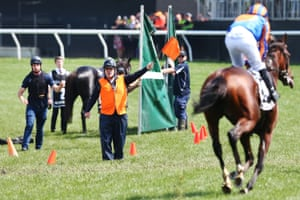 Horses are guided away from CliffsOfMoher who broke down in the first lap race 7.