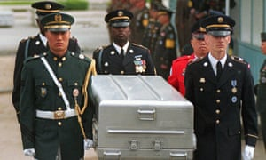 In this May 1999 photo, UN honour guards carry a casket containing remains of US soldiers killed in Korean war after they were returned from North Korea.