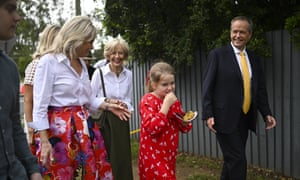 Bill Shorten and his family walk home after attending the Easter service at St Andrew's Anglican Church in Brisbane