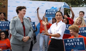 Democratic congressional candidate Katie Porter, left, is introduced by former Olympic medalist ice skater Michelle Kwan to students and supporters before voting early at the University of California campus in Irvine, California, on Tuesday.