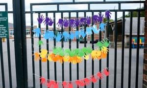 Hand artwork on a school gate in Sheffield