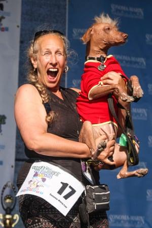 Rona Thau holds her dog Morris
