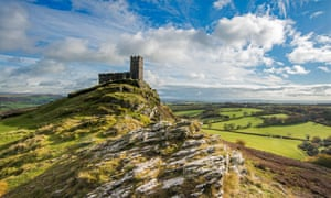 On a sunny day, the church of St Michael de Rupe, atop Brent Tor, Devon