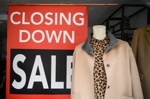"""A sign reading """"Closing Down Sale"""" is seen in the window of a Jaeger clothing store. The chain is among a number of businesses to announce their closure, blaming the inability to survive the financial impact of national lockdowns and social restrictions."""