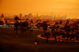 Downtown San Francisco is seen from Dolores Park under an orange sky darkened by smoke.Wednesday, 9 September 2020, in San Francisco, California.
