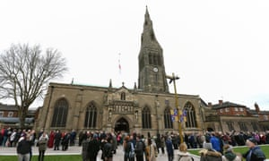 People queue outside Leicester Cathedral to view the coffin holding the remains of Richard III.