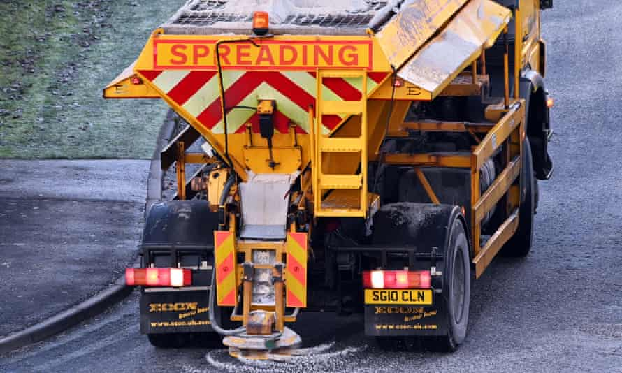 A gritter lorry treats an icy suburban road in Dalgety Bay, Scotland