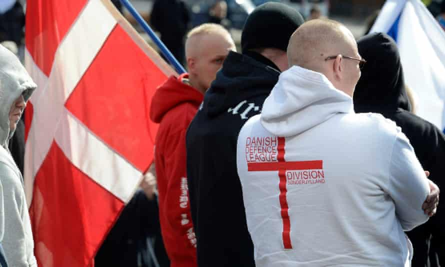 Members of the Danish Defence League, with Danish flags, at a far-right rally in Aarhus.