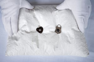 The locket on the left has Dickens' hair in it and was given to his sister-in-law Mary Hogarth. The one on the right with Hogarth's hair belonged to Dickens