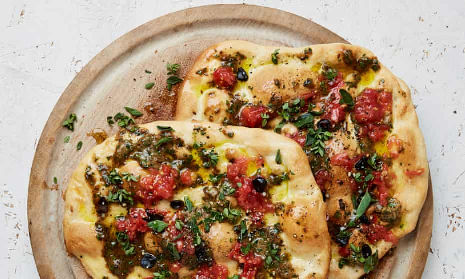 Yotam Ottolenghi's olive-oil flatbread with three-garlic butter.