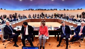 Left to right: Trump, China's president, Xi Jinping, Merkel, Argentina's president, Mauricio Macri and Australia's PM, Malcolm Turnbull, at the first working session