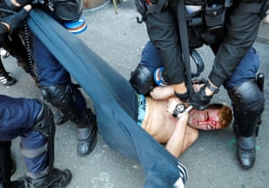 Hendaye, France: A demonstrator is detained after a protest march during the G7 summit