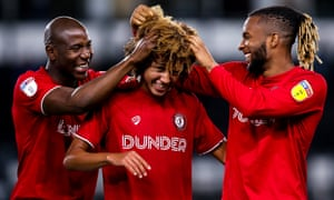 Han-Noah Massengo, centre, has been an instant hit with Bristol City fans after signing from Monaco.