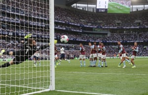 Aston Villa goalkeeper Tom Heaton makes a save from a free kick, watched by his teammates in the defensive wall