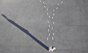 Woman looking at diverging footprints