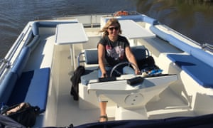Mary driving the boat.