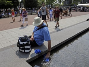 Doug Cronk dips a towel into a fountain outside of Arthur Ashe Stadium. Dangerously high heat in the Northeastern United States has prompted emergency measures including extra breaks for players.