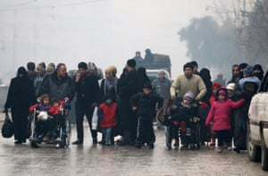 People fleeing deeper into the remaining rebel-held areas of Aleppo