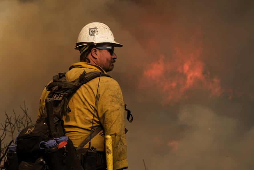 A firefighter watches as the Alisal fire burns through the coastal mountains near Goleta, California, on Wednesday.