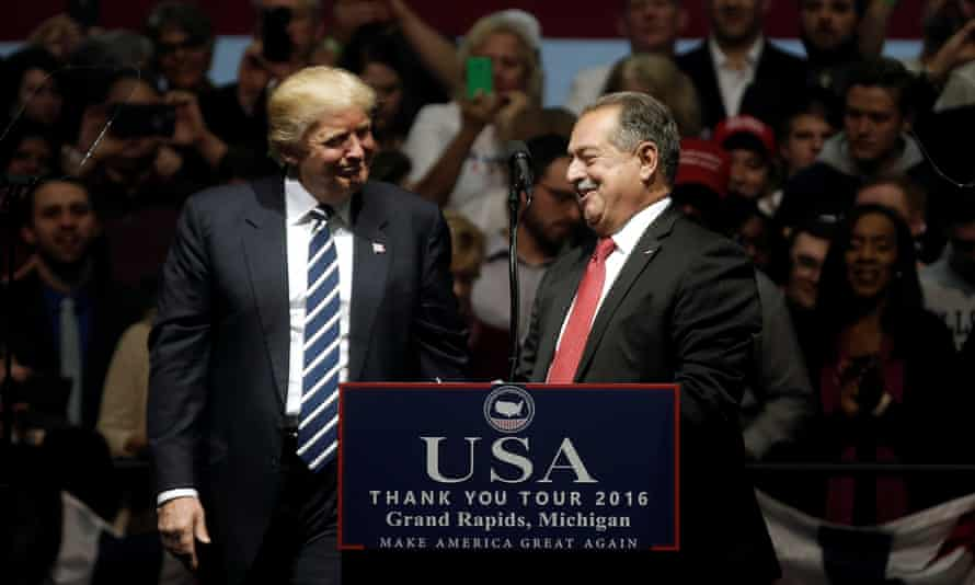 Donald Trump greets Andrew N Liveris, chairman and CEO of Dow Chemical, at a rally in Grand Rapids, Michigan, in December 2016.
