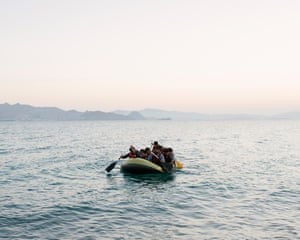 Refugees arrive on Kos at dawn, having paddled by dinghy from the Turkish coast