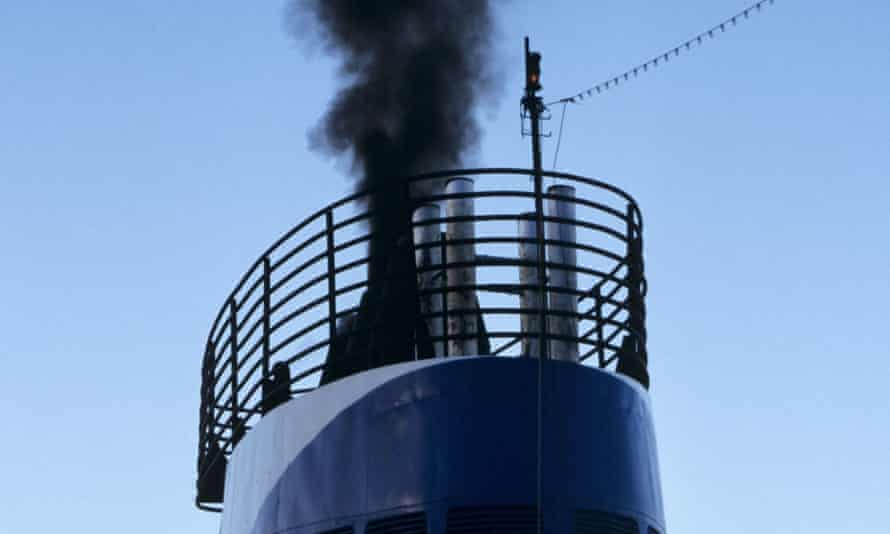 Black smoke pours from a ship's funnel