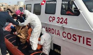 Survivors arrive at the Lampedusa harbour