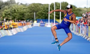 Sweden's Ludwig Fleetwood celebrates finishing the triathlon at Strathclyde Country Park in Glasgow on Friday.