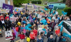 Parents and children protesting outside the school in April