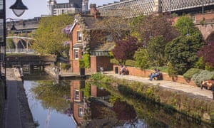 People enjoy the warm April weather in Castlefield, Manchester.