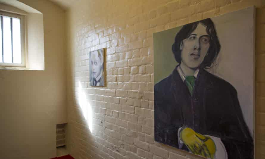 A painting of Oscar Wilde hangs inside a cell in the former Reading prison building.