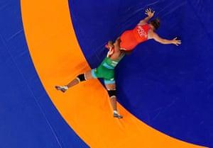 Nigeria's Blessing Oborududu (bottom) of Nigeria in action against Elis Manolova of Azerbaijan in the last-16 of the 68kg women's wrestling.