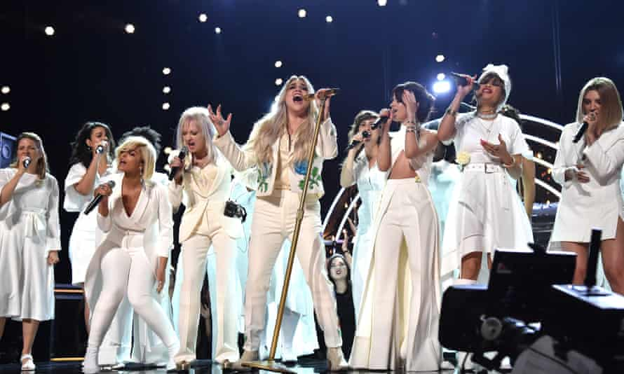 Kesha and friends in white on stage at the Grammys.