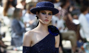 Girl with a pearl earring: a model in signature Coco chic.