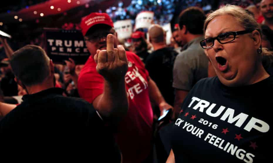 Supporters of Donald Trump scream and gesture at members of the media at a campaign rally in Cincinnati, Ohio.