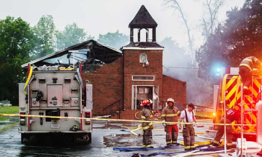 Firefighters and fire investigators respond to a fire at Mt Pleasant Baptist church in Opelousas, Louisiana, on 4 April.
