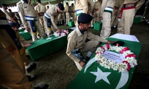 Pakistani soldiers pay tribute to their colleagues who lost their lives in a Nato attack, during their funeral in Peshawar, Pakistan on 27 November 2011.