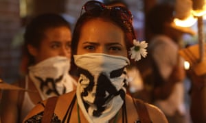 Demonstrators march for peace through the streets of Medellin on the eve of the referendum.