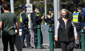 Police patrol a street in Melbourne on 6 September 2020 as the state announced an extension to its strict lockdown law while it battles fresh coronavirus outbreaks.