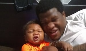 Armed security guard Jemel Roberson, shown here with his infant son, was fatally shot at his work in a Chicago bar by a white police officer.