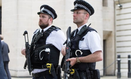 Armed police patrol Whitehall in London earlier this year.