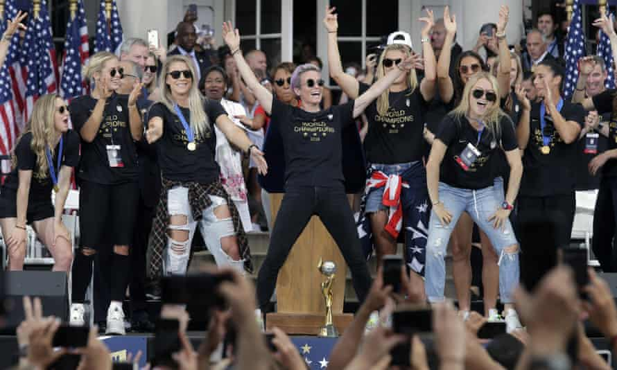 The US women's soccer team, with Megan Rapinoe, at center, celebrates at City Hall after the ticker tape parade.