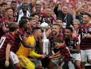 Flamengo's Diego Alves and Diego lift the trophy with teammates as they celebrate after winning the Copa Libertadores final.