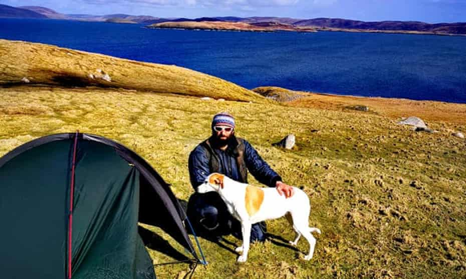 Chris Lewis and his dog, Jet