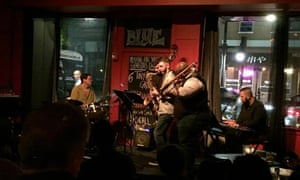 A four-piece band play on stage at Blue, Portland, Maine, USA.