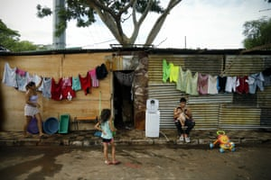 Cristaldo family members wash their clothes at a shelter after flooding