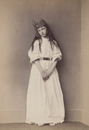 Xie Kitchin standing in nightdress and crown, also known as Captive Princess by Lewis Carroll