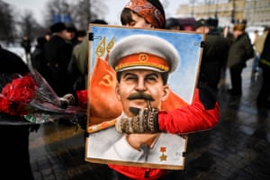 Moscow, Russia. Communist party supporters attend a memorial ceremony in Red Square to mark the 65th anniversary of Joseph Stalin's death