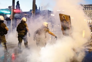 Athens, GreeceRiot police clash with anti-vaccine protesters at central Syntagma square. Tear gas was used to disperse thousands of protesters opposing the government's plans for mandatory vaccination.